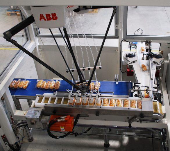 Chargement d'ensacheuse conditionnement robotisé - GEBE2